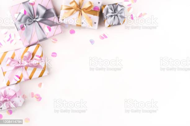 Several gift boxes with bows and confetti on a white background picture id1208414794?b=1&k=6&m=1208414794&s=612x612&h=yzhdiqzw1ffiedm cwx jkuu4c0ra6kdu9an3t63hcm=