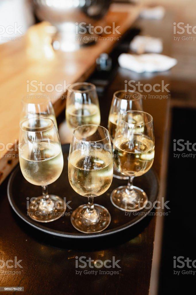 Several glass of white wine in a tray zbiór zdjęć royalty-free