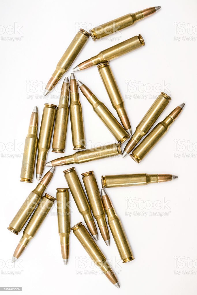 Several golden bullets sprawled out on a white background royalty-free stock photo