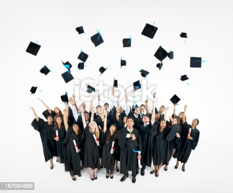 istock Several graduates tossing their hats in the air 187084686