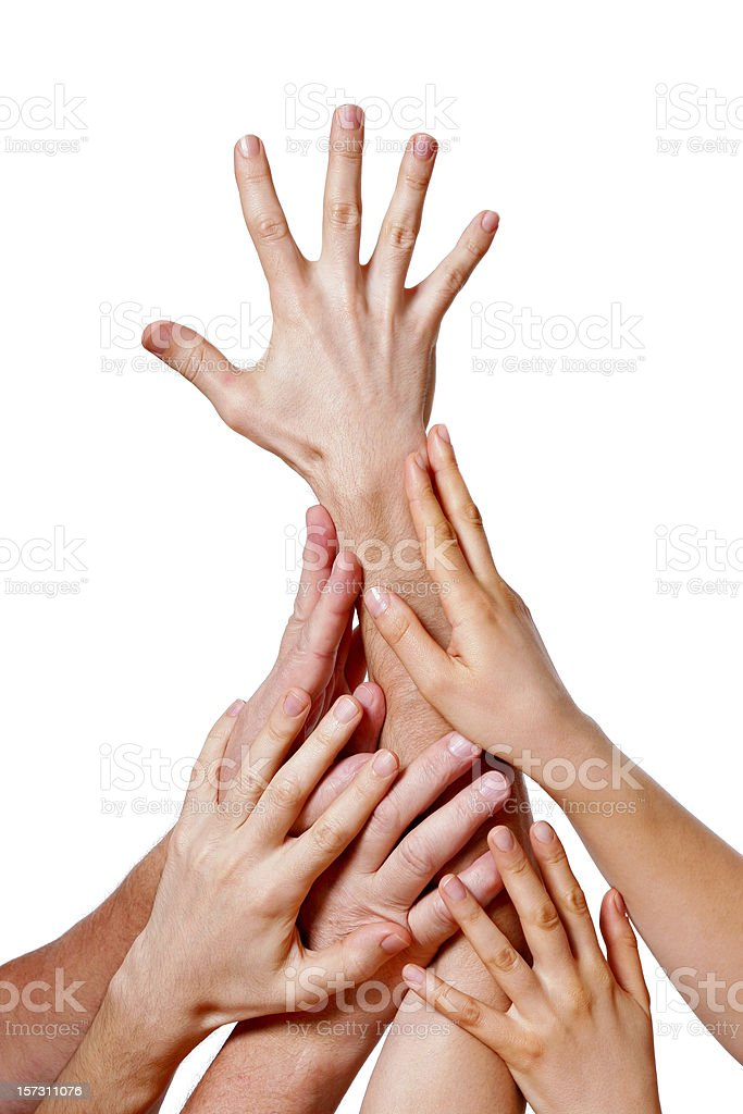 Several hands holding on to each other and racking up stock photo