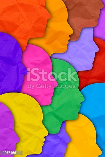 Several human silhouette faces in different colors. Diversity