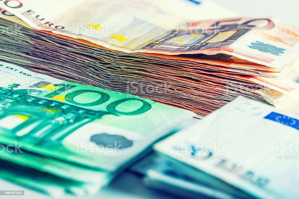 Several hundred euros in stacks by denominational values stock photo