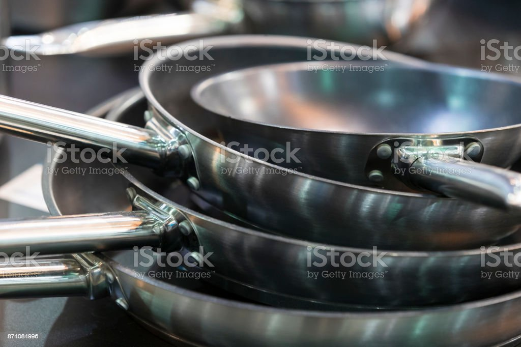 Several iron pans for cooking stock photo