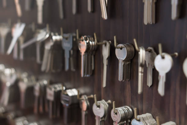 Several Keys type such as household and car key Several Keys type such as household and car key use for copying or duplicating hang on the wall in the locksmith workshop locksmith stock pictures, royalty-free photos & images