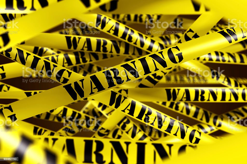 Several layers of yellow warning tape with black lettering royalty-free stock photo