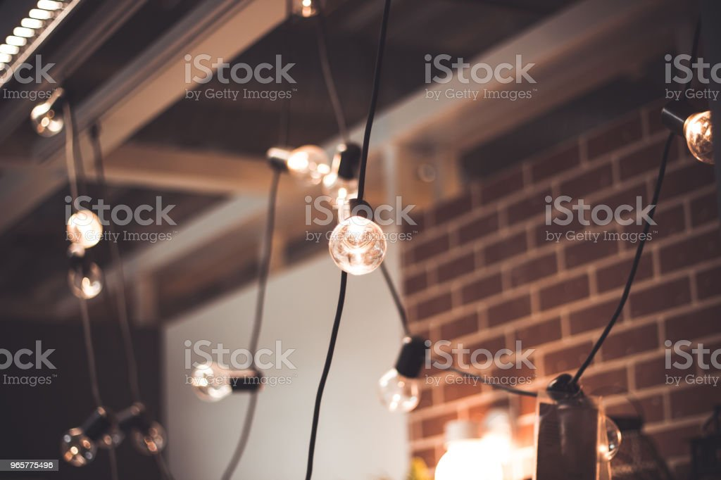 Several light bulbs suspended from the ceiling - Royalty-free Ancient Stock Photo