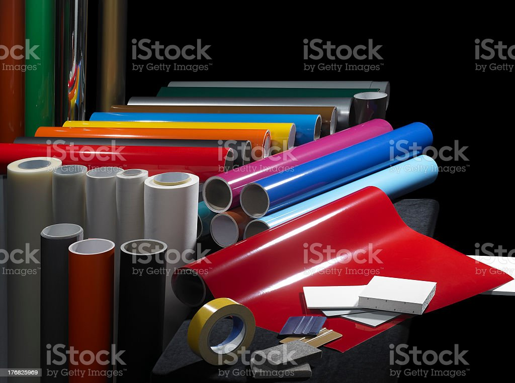 Several materials for sign making on dark background stock photo