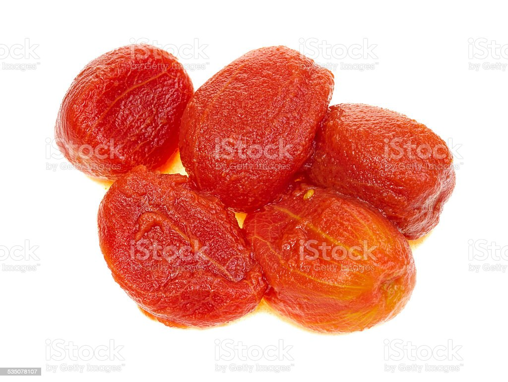 Several peeled ripe tomatoes stock photo