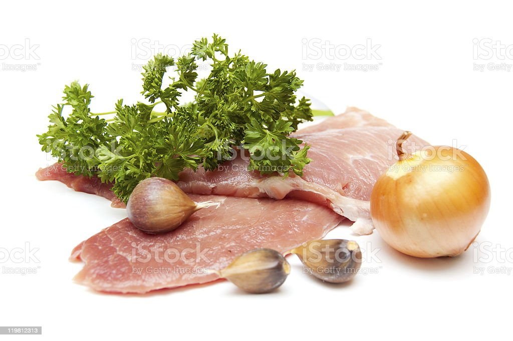 Several pieces of meat with onion isolated on white royalty-free stock photo