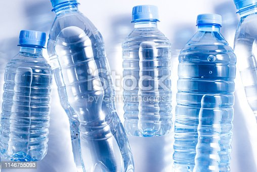 istock Several plastic water bottles on white background 1146755093