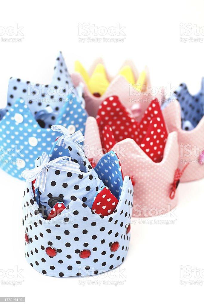 Several polka dot textile crowns stock photo