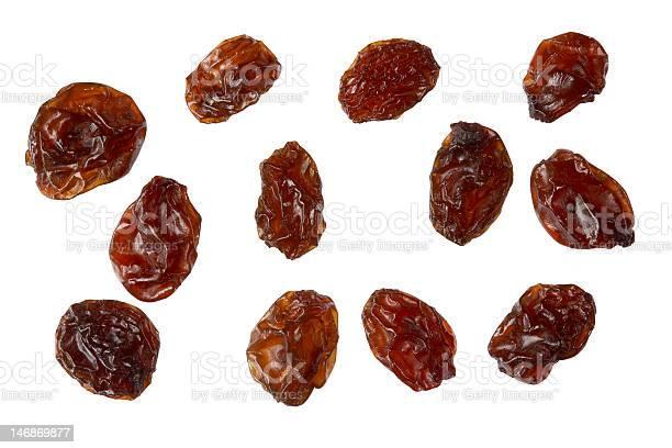 Delicious raisins isolated on white