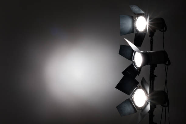 Several reflectors on the black background in photo studio. stock photo