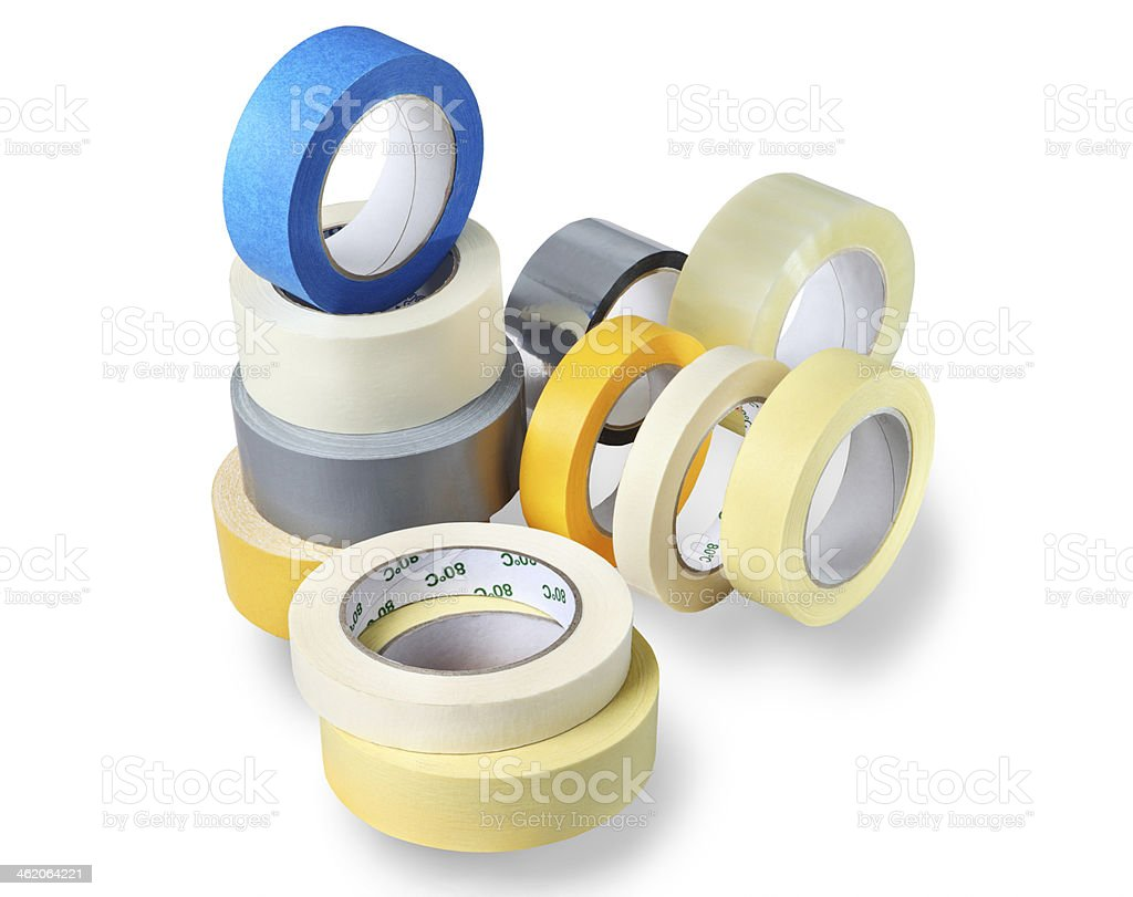 Several rolls of adhesive tapes different colors, sizes, purp stock photo
