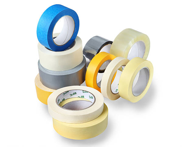 several rolls of adhesive tapes different colors, sizes, purp - adhesive tape stock photos and pictures