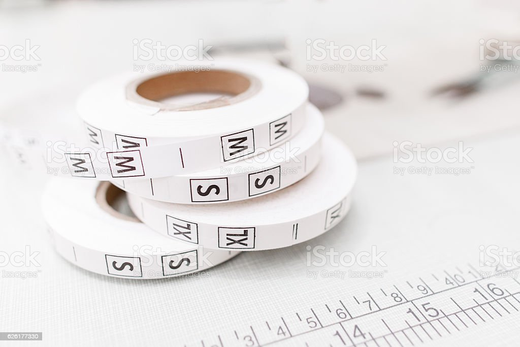 Several size tag tapes on white background stock photo