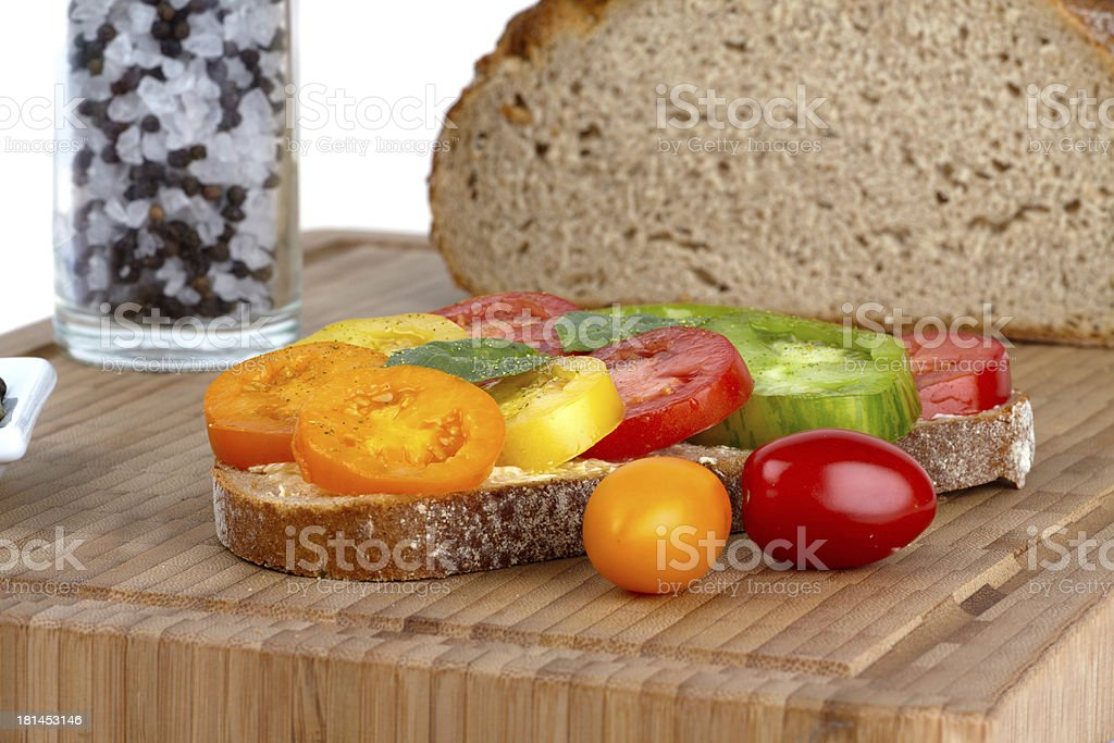Several sliced organic tomatoes on Wholemeal Bread royalty-free stock photo