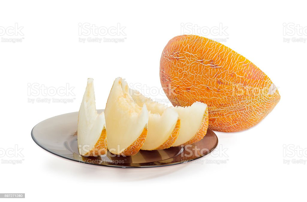 Several slices and half of melon on a light background Lizenzfreies stock-foto