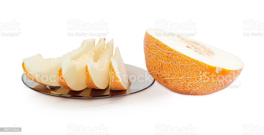 Several slices and half of melon on a light background royalty-free stock photo