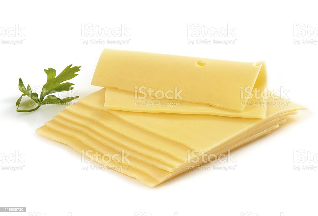 Several slices of cheese next to a parsley leaf royalty-free stock photo