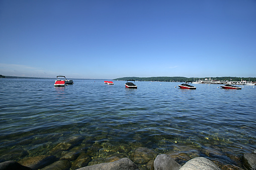 Several speedboats dock on the waters of Lake Geneva