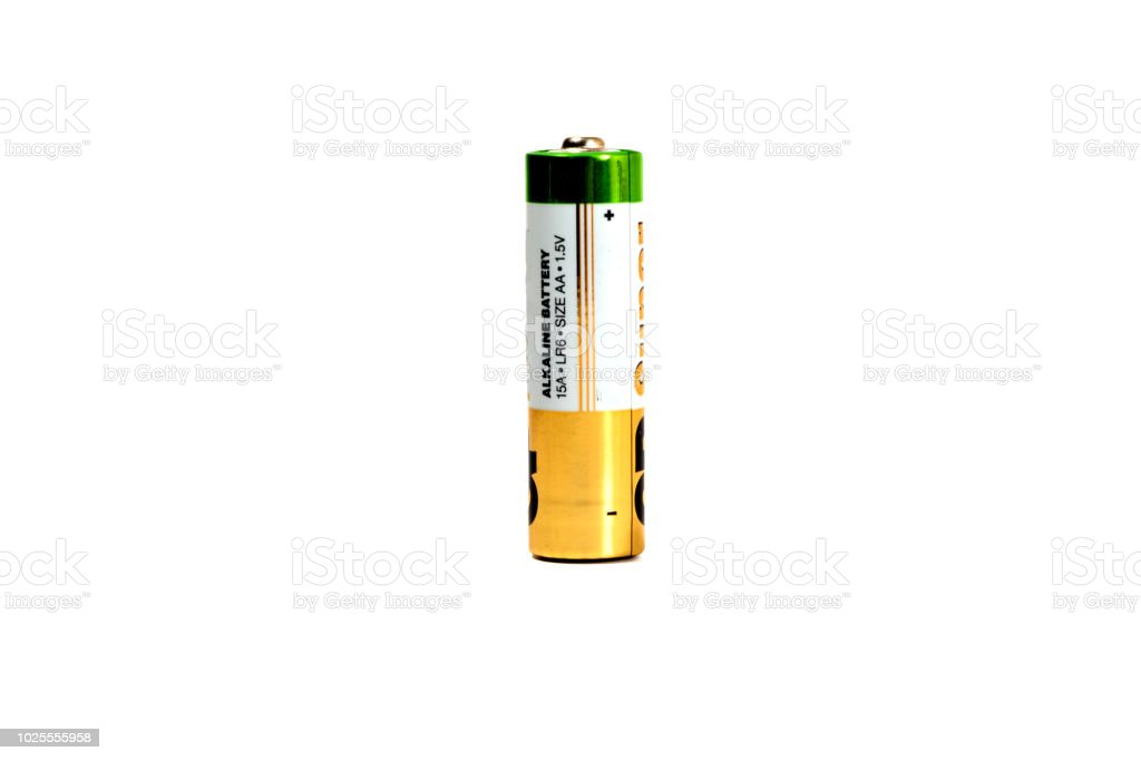 Several spent color alkaline batteries on a white background. stock photo
