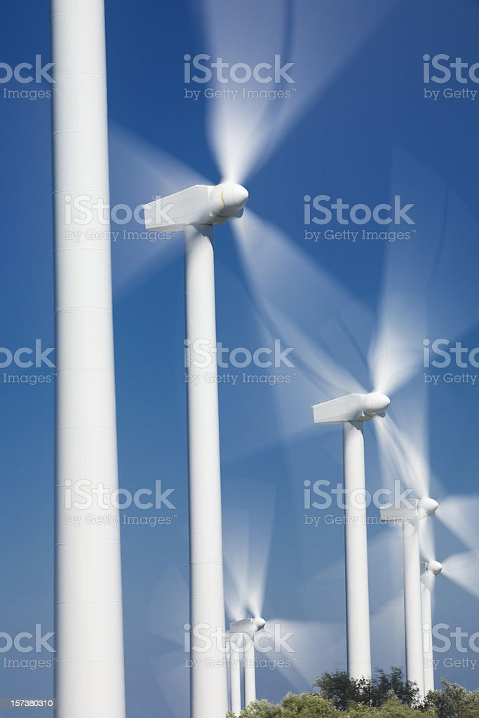 Several spinning windmills in the sunlight royalty-free stock photo