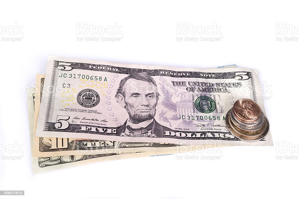 Several stacks of American coins with some dollar bills. stock photo