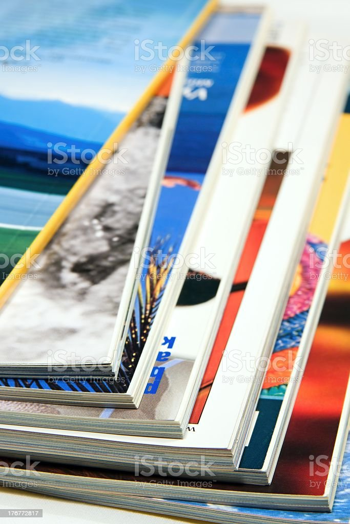 Several stacks of magazines on a table royalty-free stock photo
