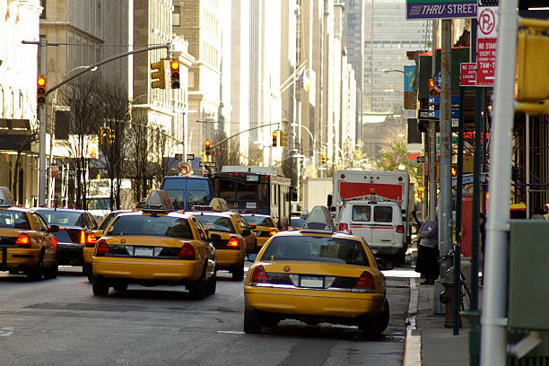 several taxis stopped in new york city downtown - mikefahl stock pictures, royalty-free photos & images