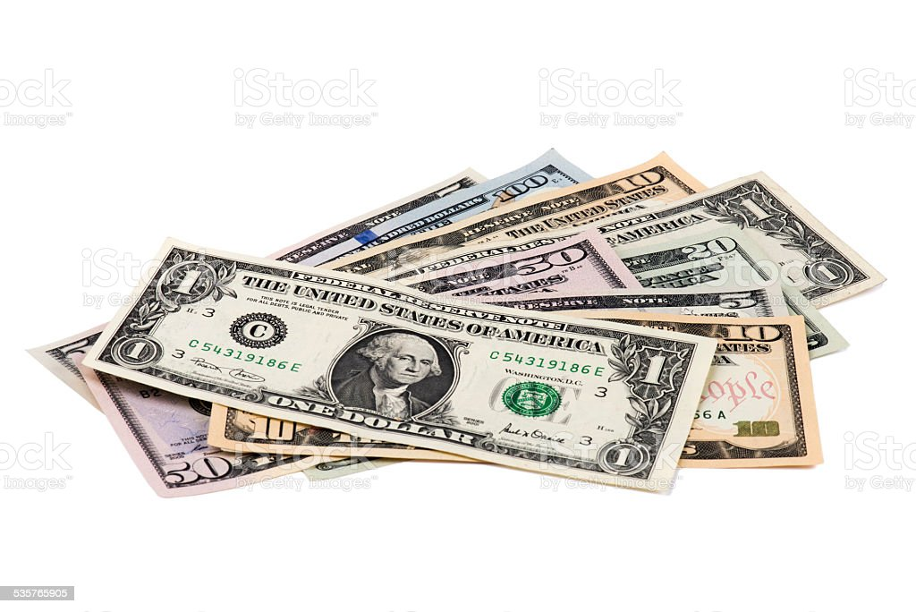 Several US Dollars on White Background stock photo