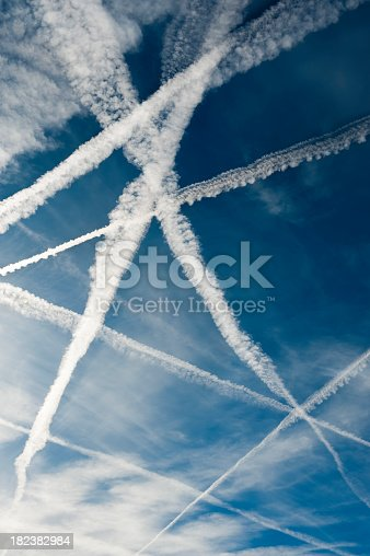 istock Several vapor trails crossing in the sky 182382984