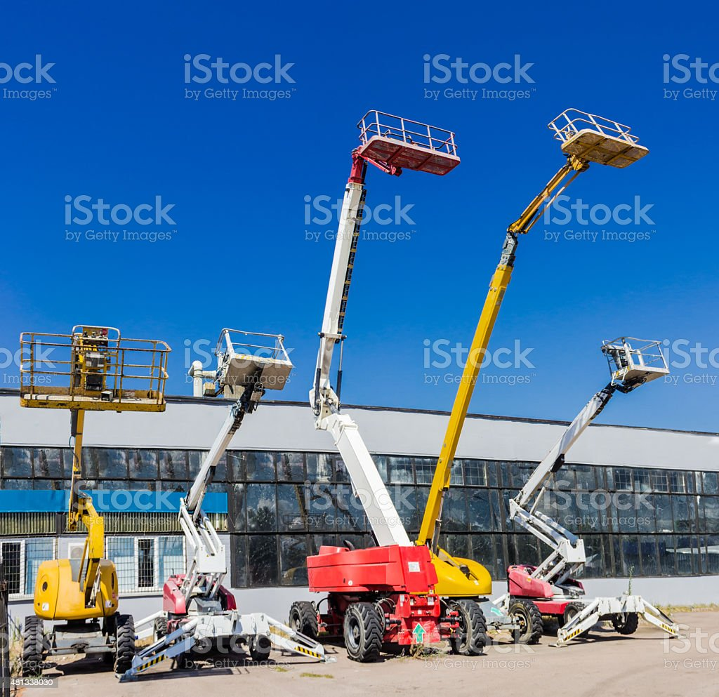 Several various self propelled articulated boom lift stock photo