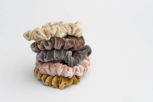 Several velvet hair ties one on top of each other isolated on white for background. stock photo
