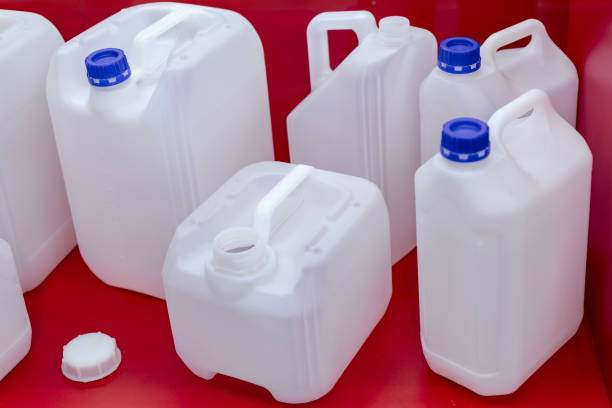 Several white plastic canister on a red background stock photo