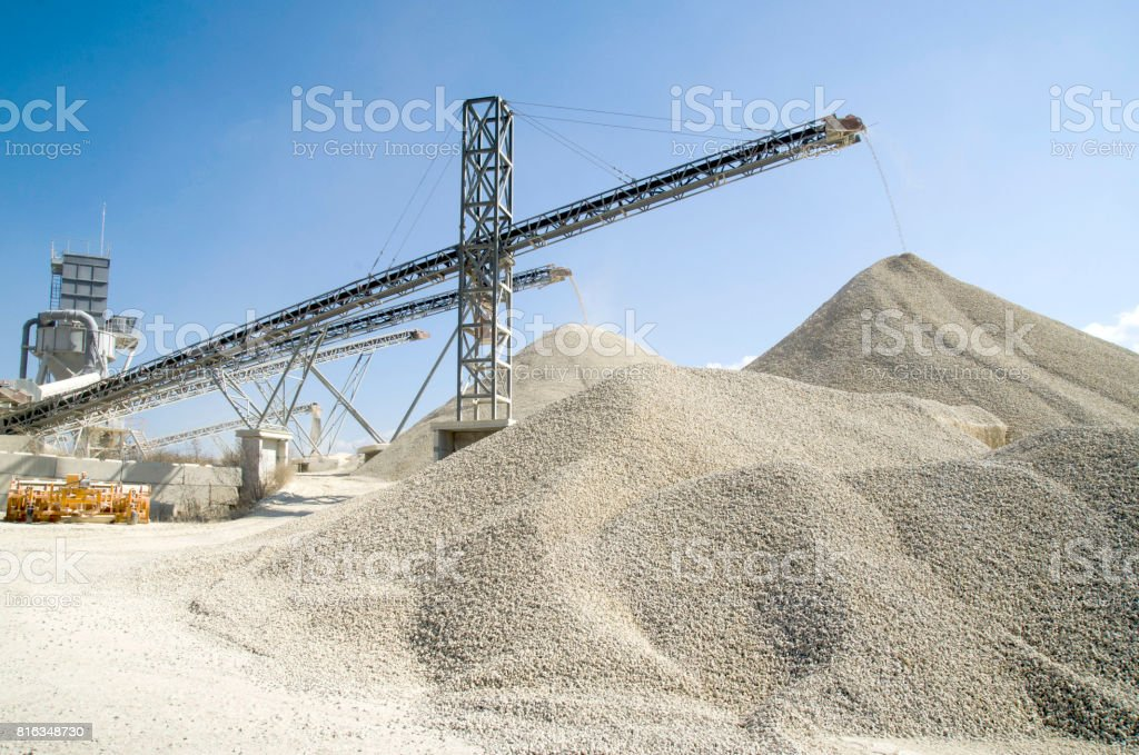 Several working belt conveyors and a piles of rubble in Gravel Quarry stock photo