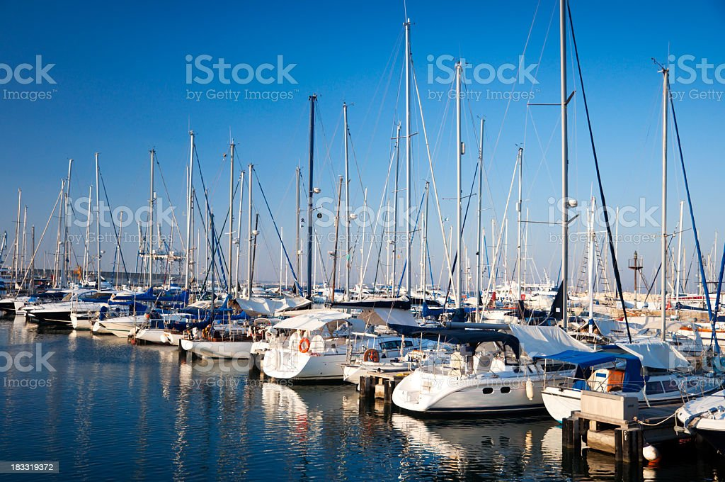 Several yachts docked at the harbor royalty-free stock photo
