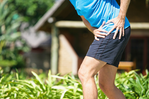 A male person, having severe hip pain, maybe due to an osteoarthritis. Please note the typical flexion of hip during pain attack. Image taken with Canon EOS 1Ds Mark II and EF 70-200mm USM L. XXL size image.