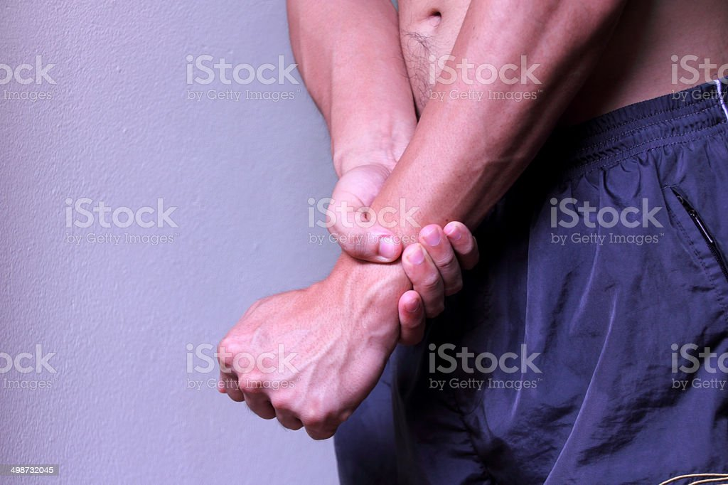 Severe pain in wrist stock photo