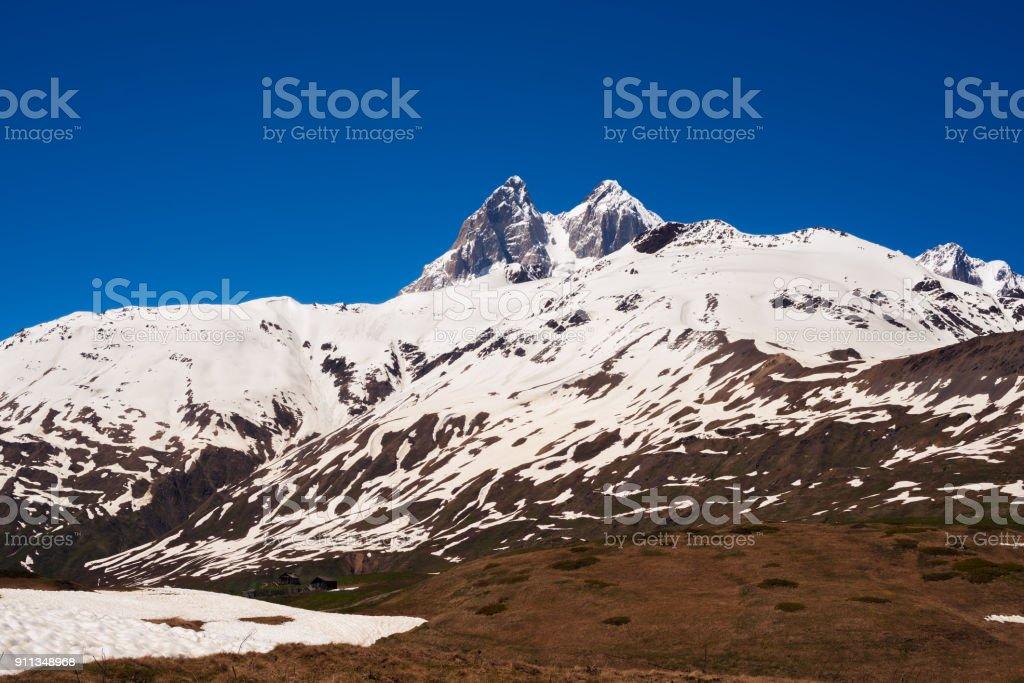 Severe rocky peaks of Ushba stock photo