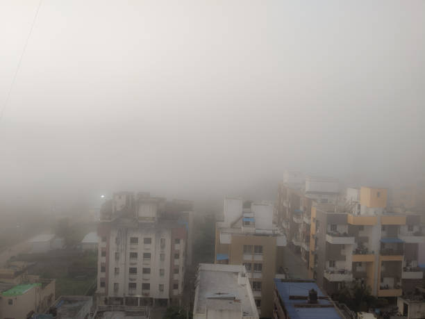 Severe smog due to air polution causing very less visibility Severe smog due to air polution causing very less visibility lahore pakistan stock pictures, royalty-free photos & images