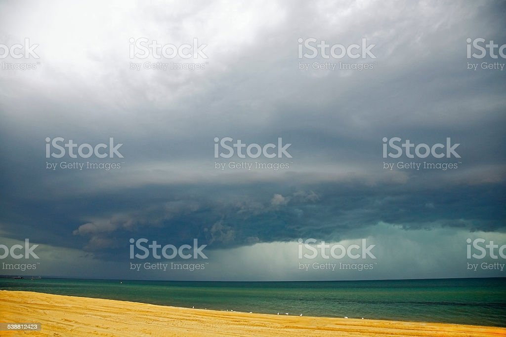 Severe thunderstorm approaches sandy beach stock photo