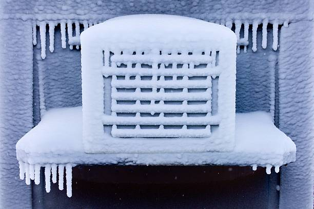Severely Frozen Air Conditioner stock photo