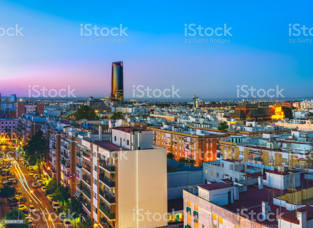 Sevilla Tower at night. View from the traditional neighborhood of Triana in Seville, Spain. stock photo
