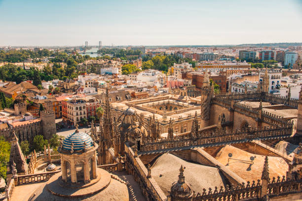 Seville Cathedral from Giralda tower Seville's cathedral as seen from Giralda Tower. santa cruz seville stock pictures, royalty-free photos & images