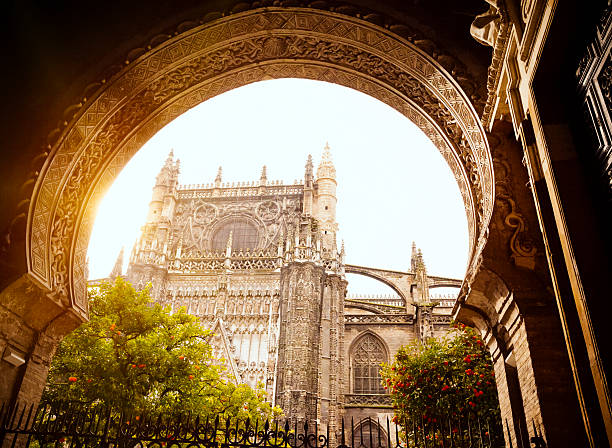 Seville Cathedral Entrance to Patio de Naranjas and Seville Cathedral (Spain). santa cruz seville stock pictures, royalty-free photos & images
