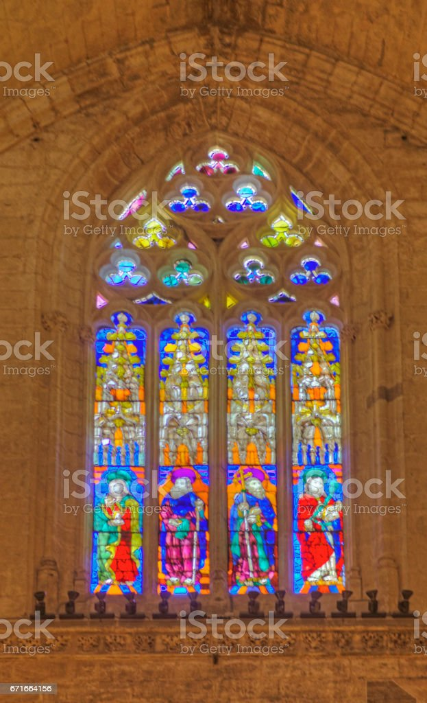 Seville Cathedral stained glass window stock photo