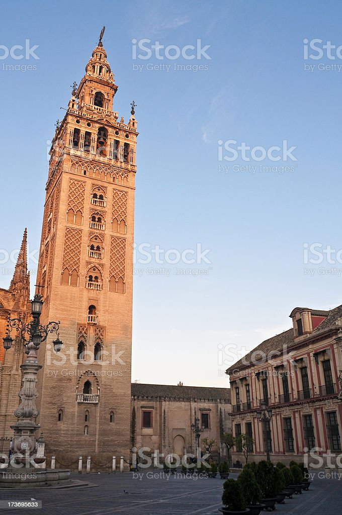 Seville La Giralda dawn glow stock photo