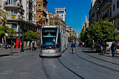 Seville,Spain.February 18, 2017.Seville Metro passing through the street of the cathedral in the heart of Seville.